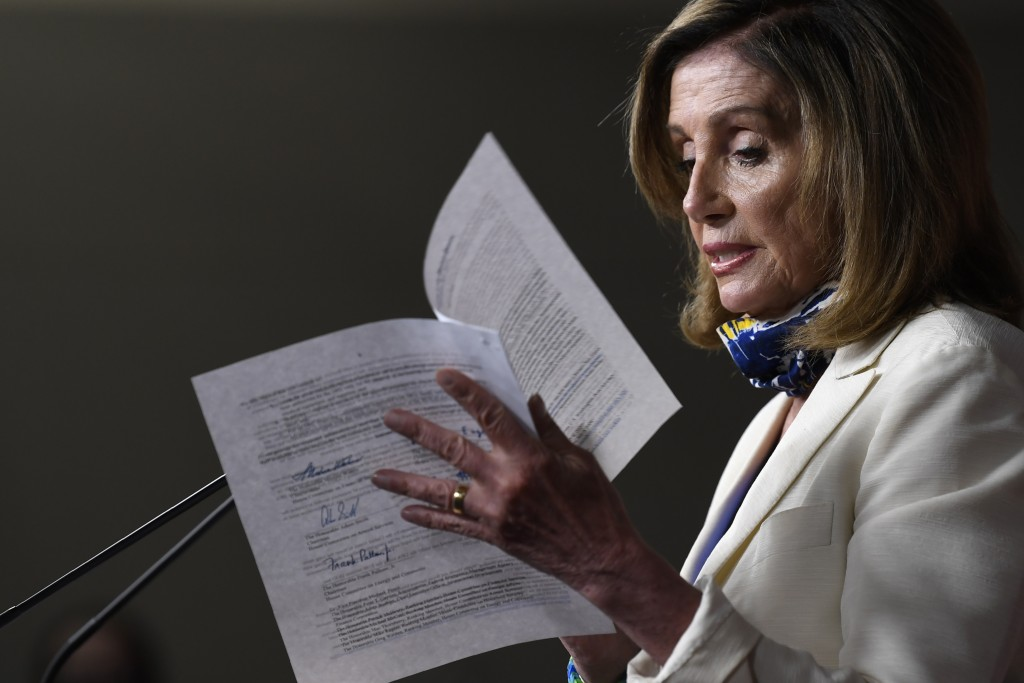 FILE - In this July 16, 2020, file photo House Speaker Nancy Pelosi of Calif., speaks during a news conference on Capitol Hill in Washington. Pelosi s...