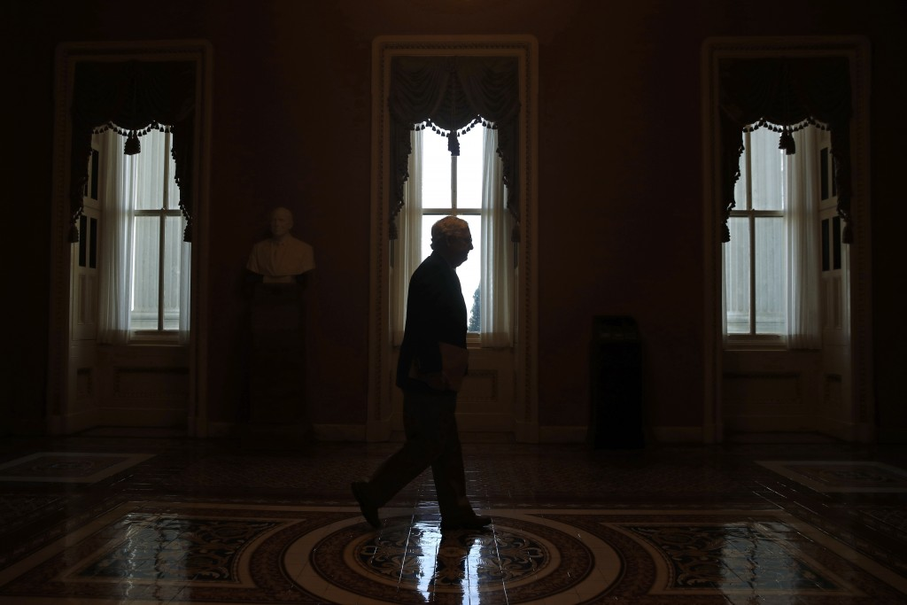 FILE - In this April 9, 2020, file photo Senate Majority Leader Mitch McConnell of Ky., walks to the Senate chamber on Capitol Hill in Washington. It'...