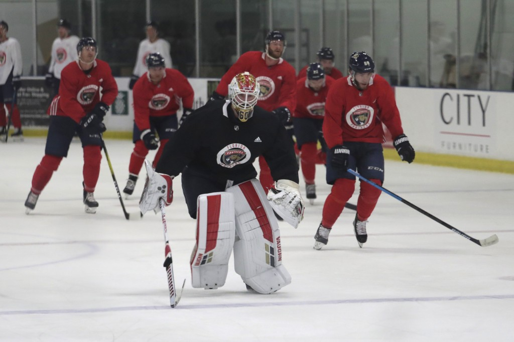 Florida Panthers goaltender Chris Driedger skates with his teammates during NHL hockey practice, Friday, July 17, 2020, in Coral Springs, Fla. (AP Pho...