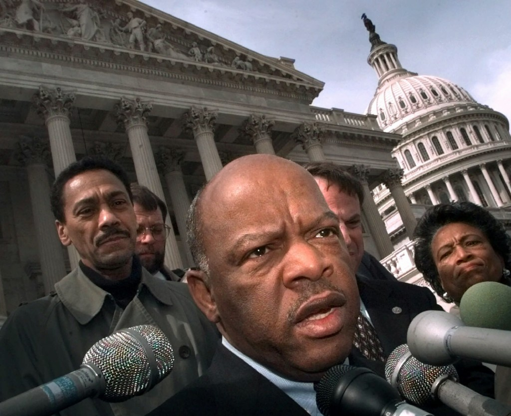 FILE - In this Friday, March 5, 1999, file photo, U.S. Rep. John Lewis, D-Ga., speaks with reporters in Washington. Lewis, who carried the struggle ag...