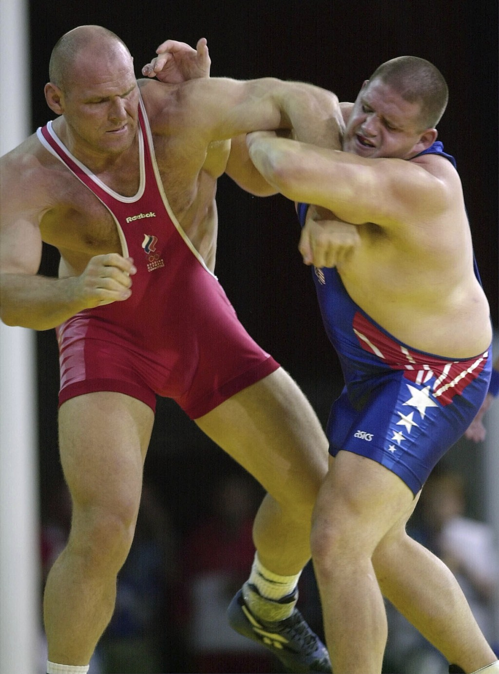 FILE - In this Sept. 27, 2000, file photo, Rulon Gardner, right, of the United States, holds the arm of Aleksandr Karelin, of Russia, during the final...