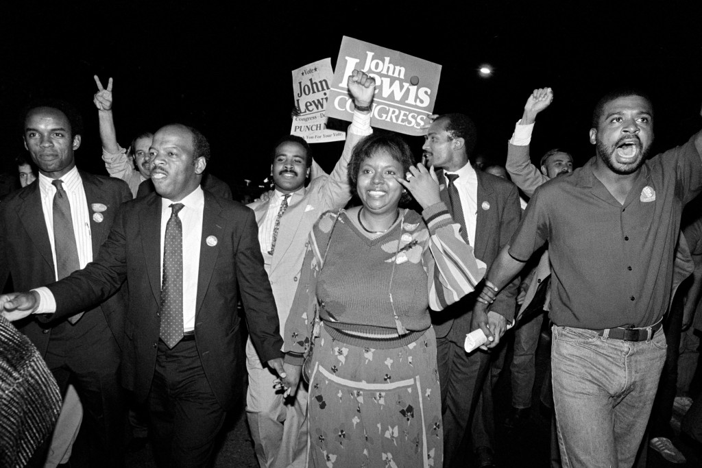 FILE - In this Tuesday night, Sept. 3, 1986, file photo, John Lewis, front left, and his wife, Lillian, holding hands, lead a march of supporters from...