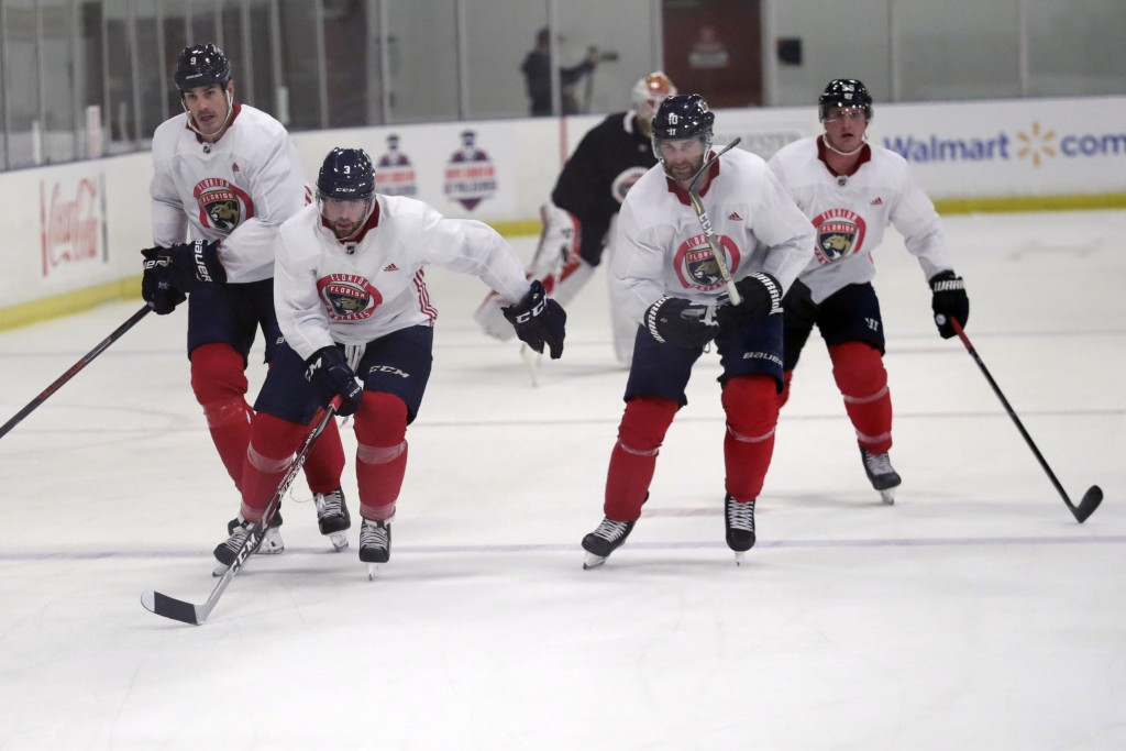 Florida Panthers' Brian Boyle, left, Keith Yandle (3), Brett Connolly (10) and Noel Acciari, right, skate during NHL hockey practice, Friday, July 17,...