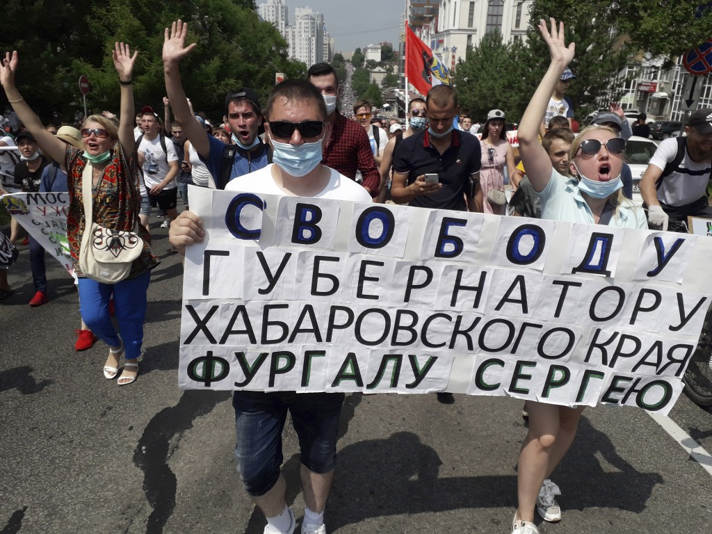 """People hold posters reading """"Freedom for Khabarovsk region's governor Sergei Furgal"""" during an unsanctioned protest in support of Furgal, who was inte..."""