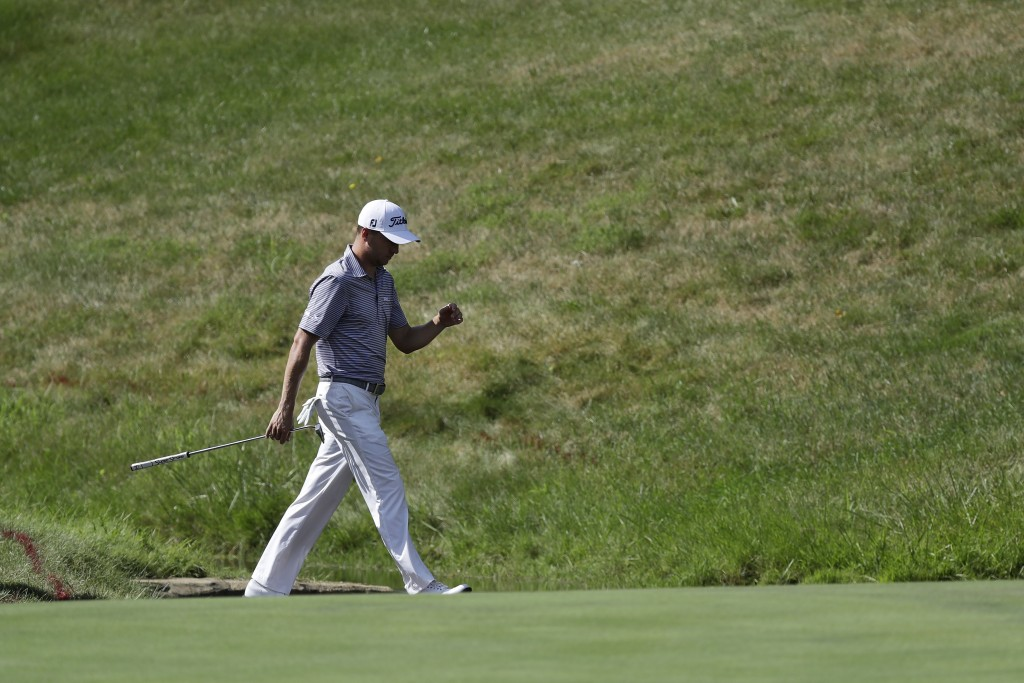 Justin Thomas walks to the 14th green during the second round of the Memorial golf tournament, Friday, July 17, 2020, in Dublin, Ohio. (AP Photo/Darro...