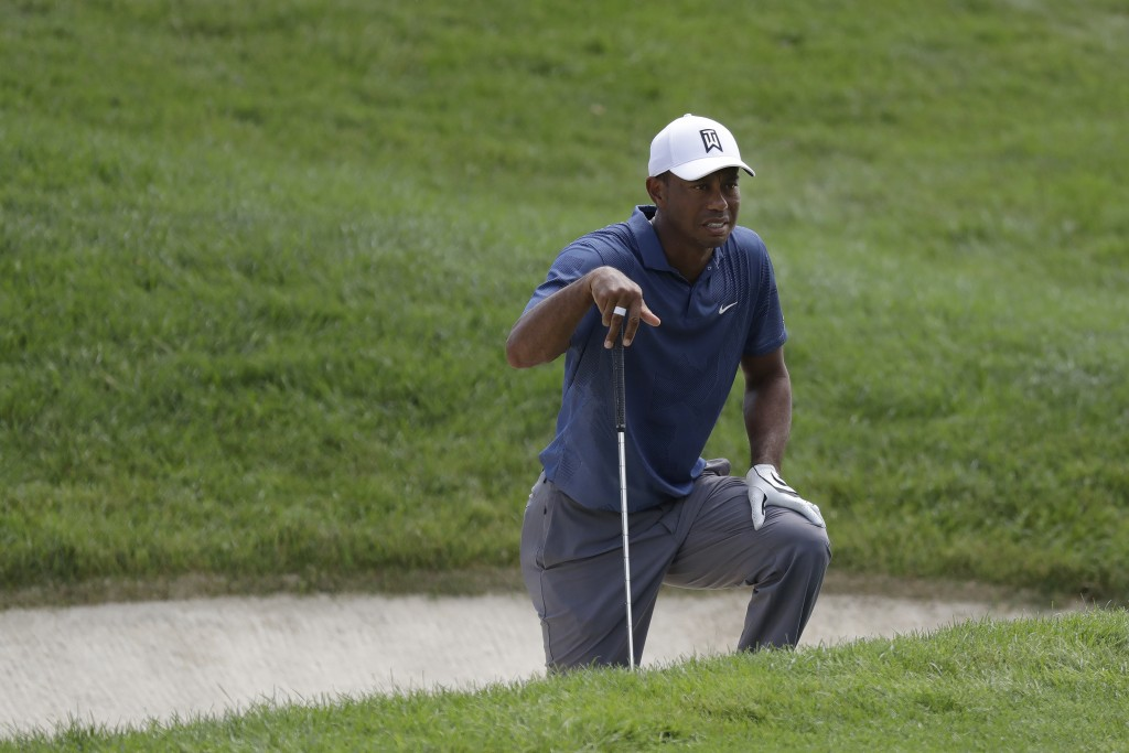 Tiger Woods looks toward the fourth hole during the second round of the Memorial golf tournament, Friday, July 17, 2020, in Dublin, Ohio. (AP Photo/Da...