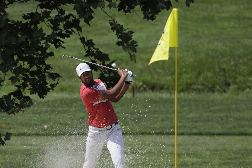 Tony Finau hits from a bunker toward the fourth green during the second round of the Memorial golf tournament, Friday, July 17, 2020, in Dublin, Ohio....