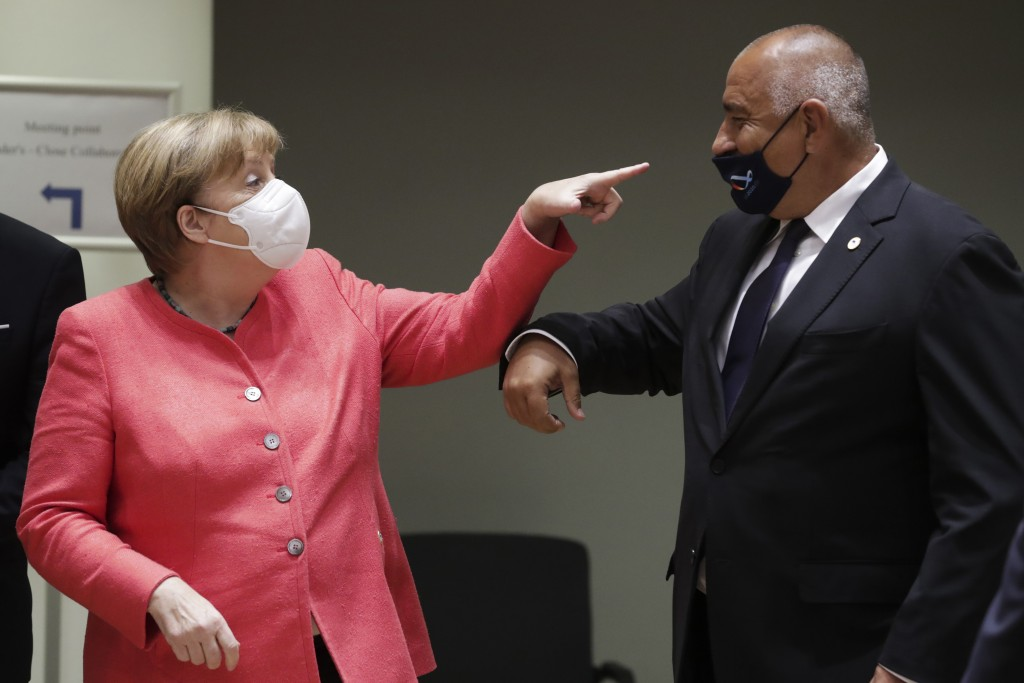 German Chancellor Angela Merkel, left, speaks with Bulgaria's Prime Minister Boyko Borissov during a round table meeting at an EU summit in Brussels, ...