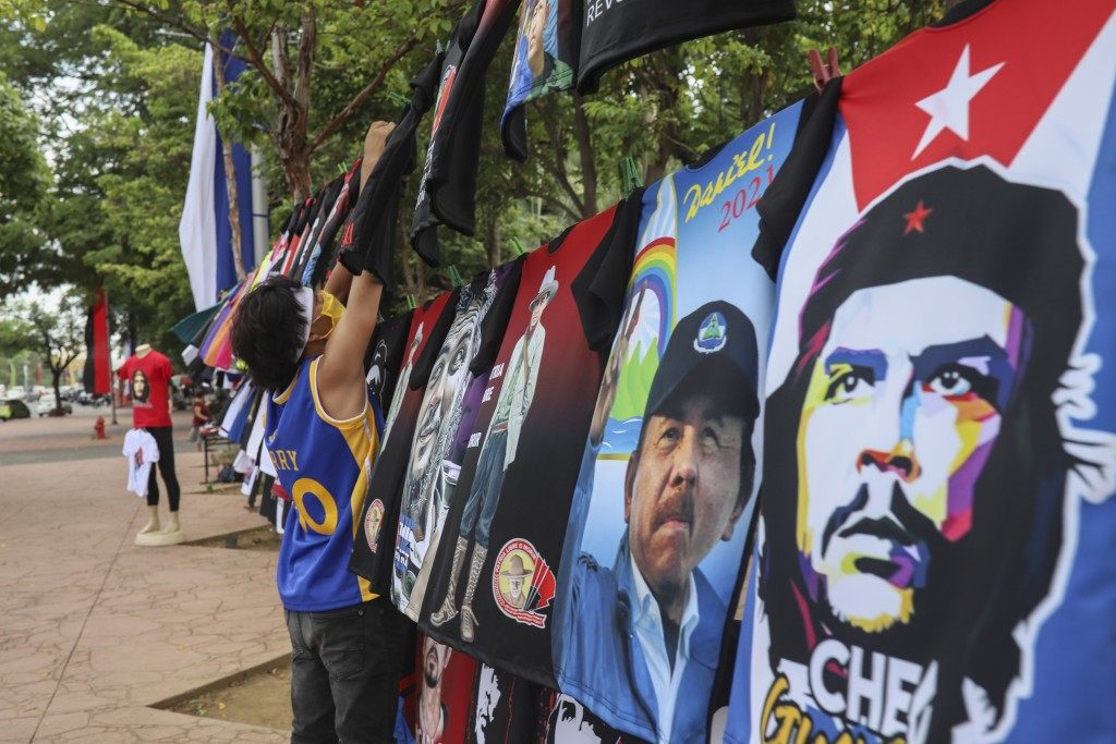 A vendor sells T-shirts promoting Nicaraguan President Daniel Ortega and The Sandinista National Liberation Front ruling party on the sidelines of a n...