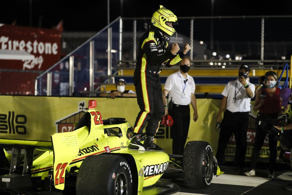 Simon Pagenaud, of France, celebrates in Victory Lane after winning an IndyCar Series auto race Friday, July 17, 2020, at Iowa Speedway in Newton, Iow...