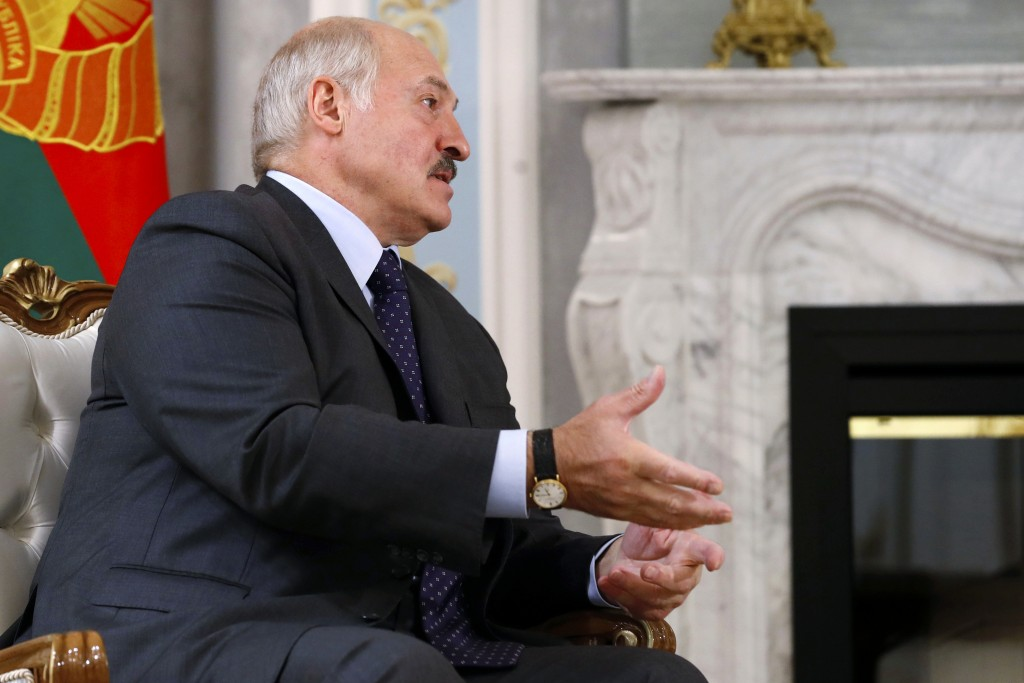 Belarusian President Alexander Lukashenko gestures while speaking to Russian Prime Minister Mikhail Mishustin during their talks on a sideline of the ...