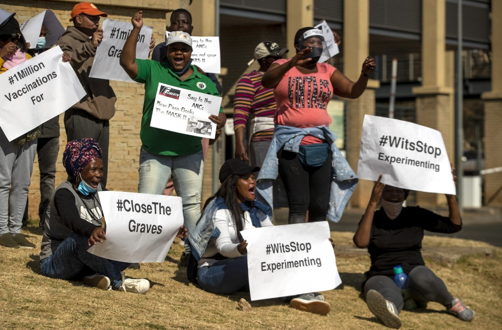 People protest against coronavirus trials in Africa, outside Chris Hani Baragwanath Hospita in the township of Soweto in Johannesburg, South Africa, S...
