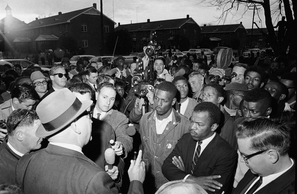 FILE - In this Feb. 23, 1965, file photo, Wilson Baker, left foreground, public safety director, warns of the dangers of night demonstrations at the s...