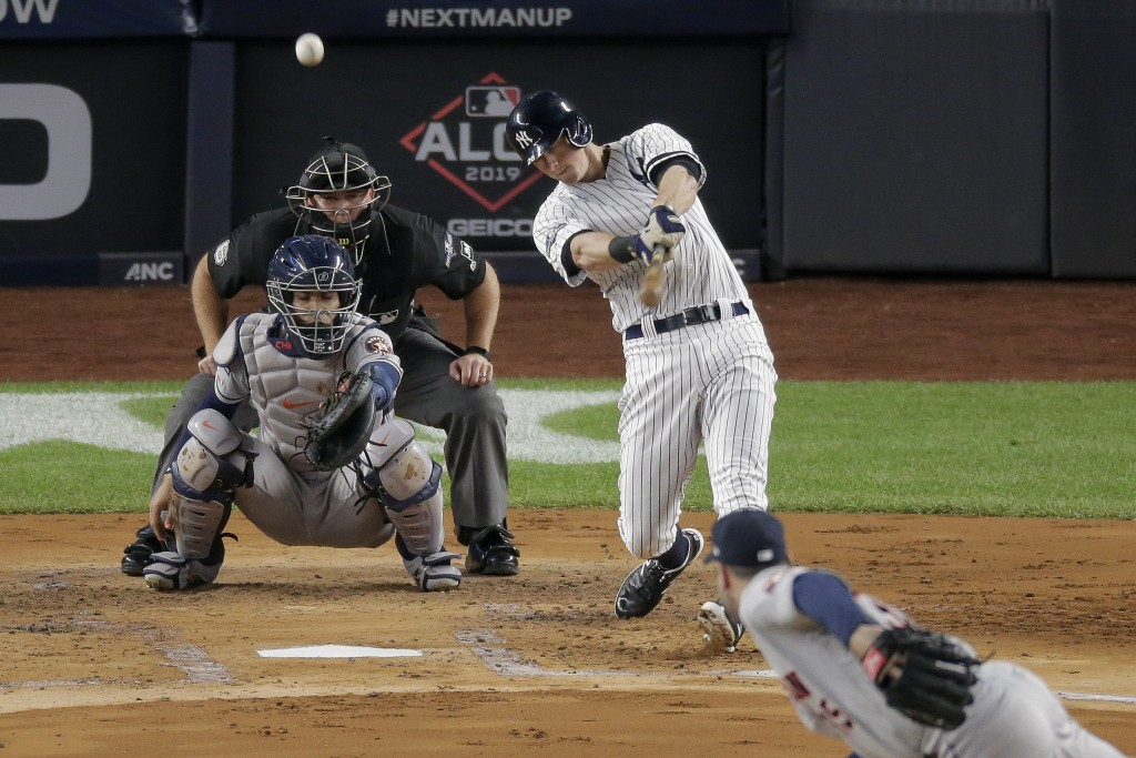 FILE - In this Oct. 18, 2019, file photo, New York Yankees' DJ LeMahieu, top right, connects for a solo home run against the Houston Astros during the...