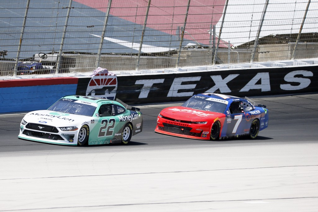 Austin Cindric (22) and Justin Allgaier (7) come out of Turn 4 during the NASCAR Xfinity auto race at Texas Motor Speedway in Fort Worth, Texas, Satur...