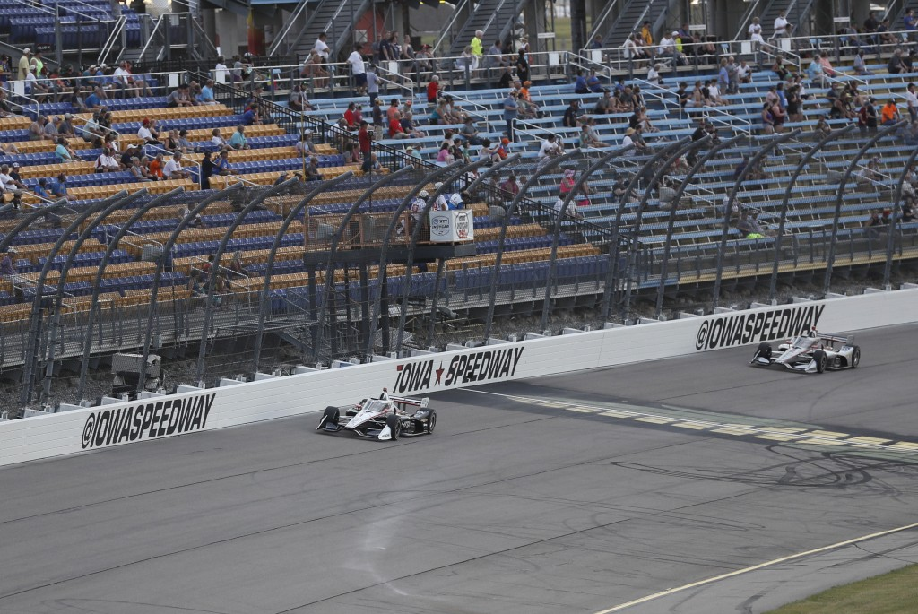 Josef Newgarden leads Will Power, of Australia, right, during the IndyCar Series auto race, Saturday, July 18, 2020, at Iowa Speedway in Newton, Iowa....