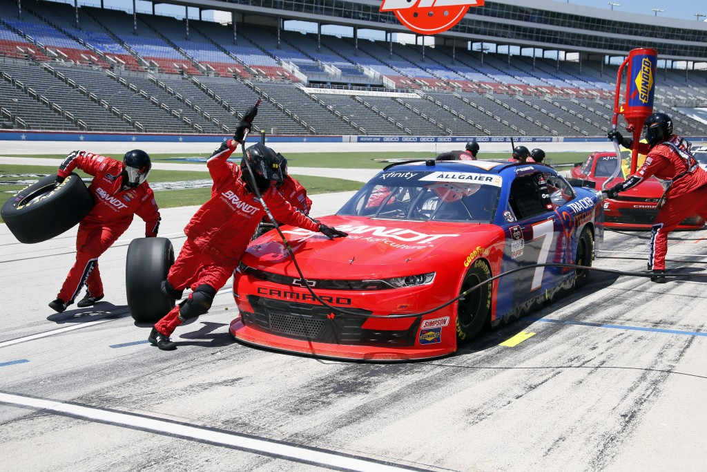 Justin Allgaier makes a pit stop during the NASCAR Xfinity Series auto race at Texas Motor Speedway in Fort Worth, Texas, Saturday, July 18, 2020. (AP...