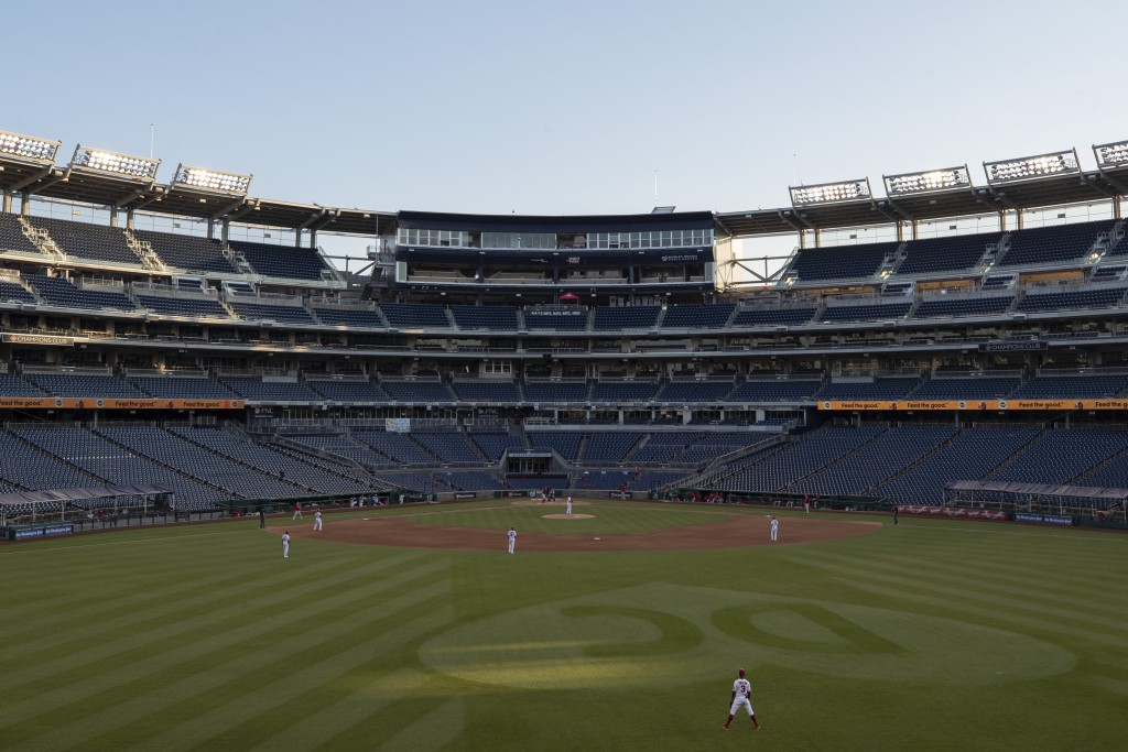 The stands are empty during an exhibition baseball game between the Washington Nationals and the Philadelphia Phillies at Nationals Park, Saturday, Ju...