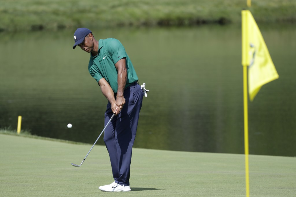 Tiger Woods hits toward the 16th hole during the third round of the Memorial golf tournament, Saturday, July 18, 2020, in Dublin, Ohio. (AP Photo/Darr...