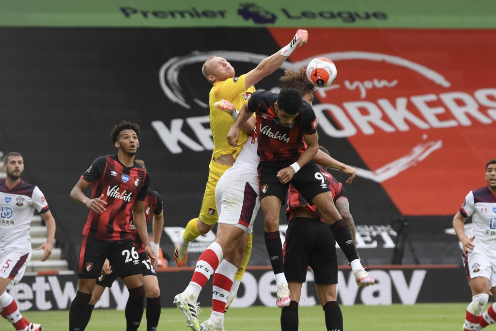 Bournemouth's goalkeeper Aaron Ramsdale punches to clear the ball during the English Premier League soccer match between Bournemouth and Southampton, ...