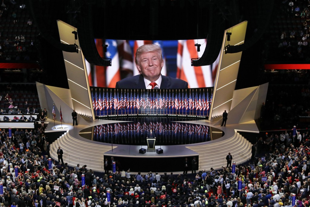 FILE - In this July 21, 2016, file photo then Republican presidential candidate Donald Trump smiles as he addresses delegates during the final day ses...