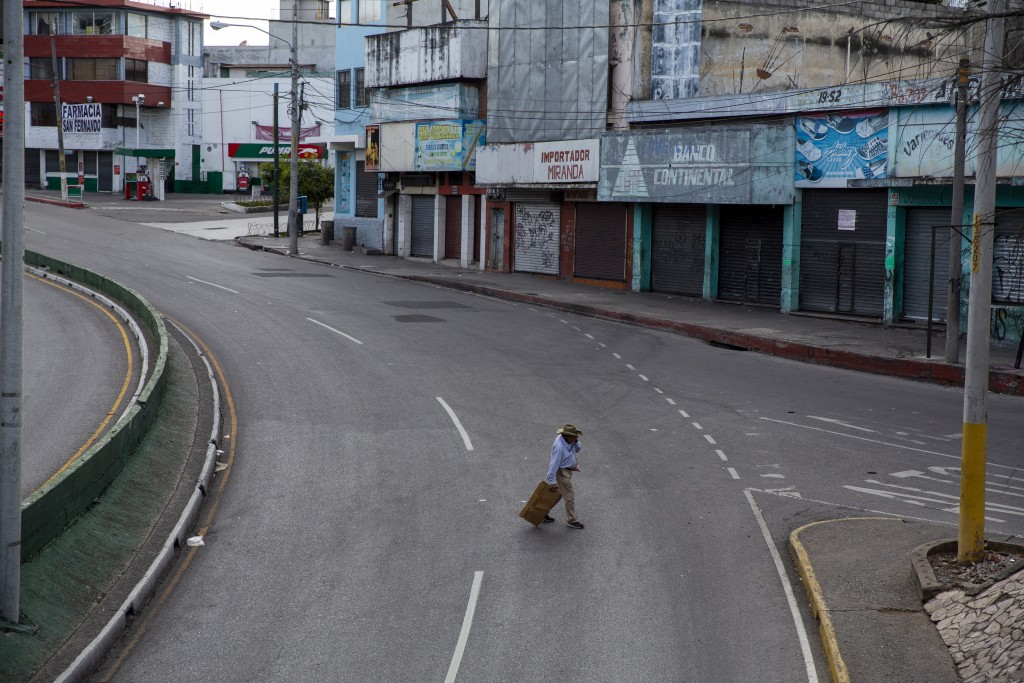 An older man walks through an empty street during lockdown to stop the spread of the coronavirus in Guatemala City, Saturday, July 18, 2020. (AP Photo...