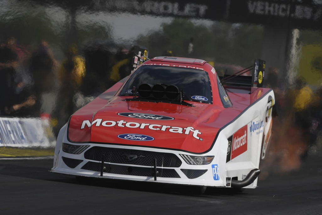In this photo provided by the NHRA, Bob Tasca III is back in the seat of his Funny Car and powers his way to the top of field after a battle of COVID-...