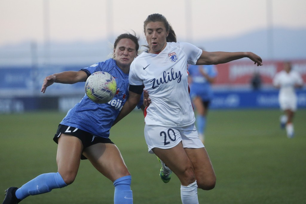 Chicago Red Stars' Bianca St. Georges, left, and Reign's Sofia Huerta (20) battle for the ball during the first half of an NWSL Challenge Cup soccer m...