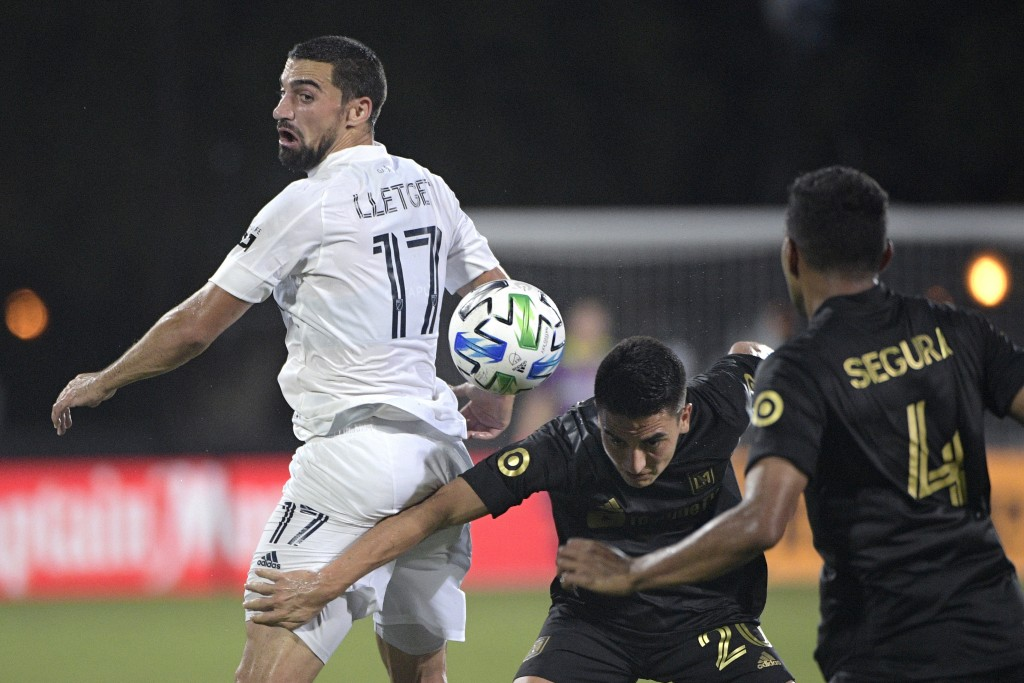 LA Galaxy midfielder Sebastian Lletget (17) competes for the ball with Los Angeles FC midfielder Eduard Atuesta (20) and defender Eddie Segura (4) dur...