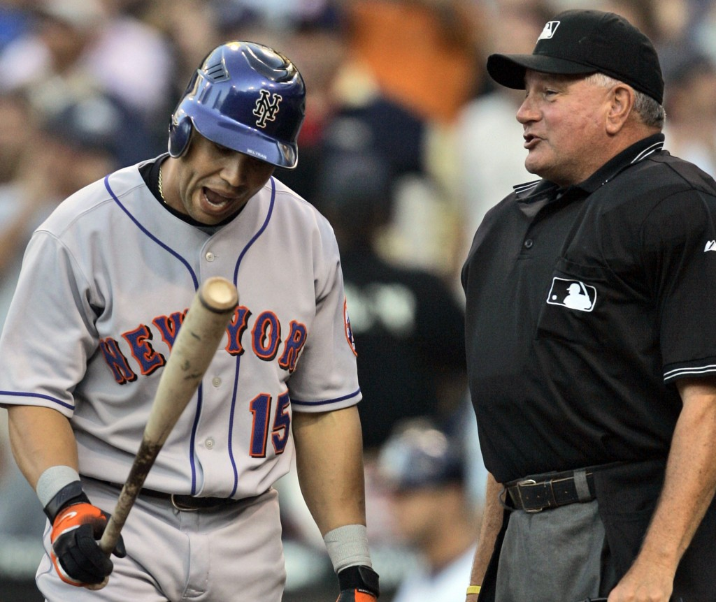 FILE - In this July 18, 2007, file photo, New York Mets' Carlos Beltran, left, disagrees with umpire Rick Reed after being called out on strikes in th...