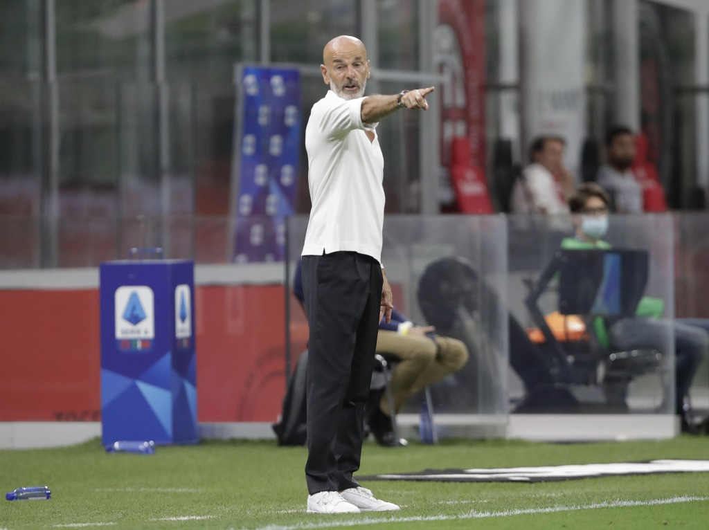 AC Milan's manager Stefano Pioli gives instructions to his players during a Serie A soccer match between AC Milan and Bologna, at the San Siro stadium...