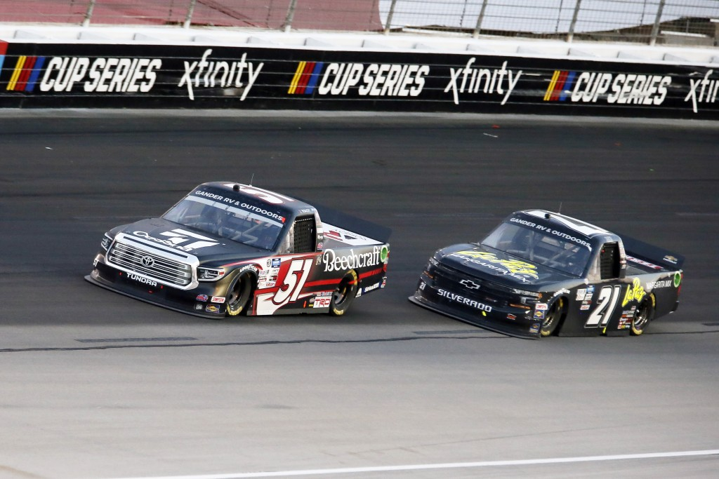Kyle Busch (51) and Zane Smith (21) come out of Turn 4 during the NASCAR Trucks race at Texas Motor Speedway in Fort Worth, Texas, Saturday, July 18, ...