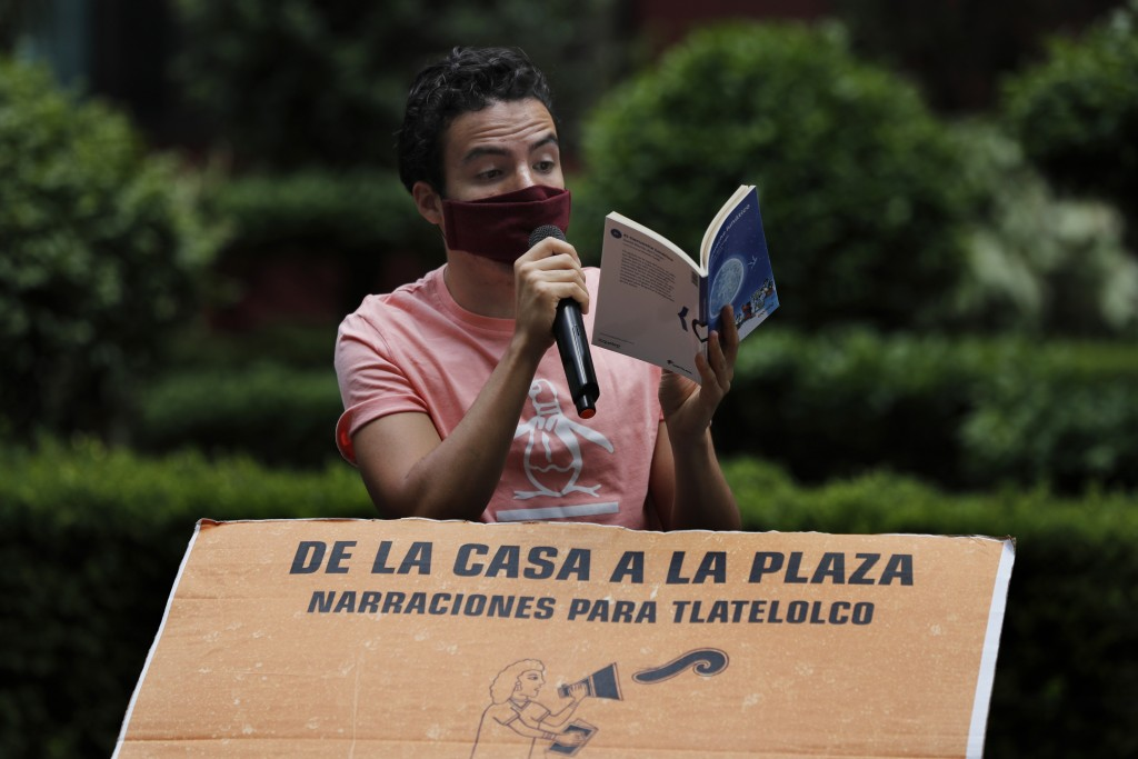 Percibald Garcia uses a microphone to read aloud children's stories amid the high-rise housing complex of Tlatelolco, in Mexico City, Saturday, July 1...