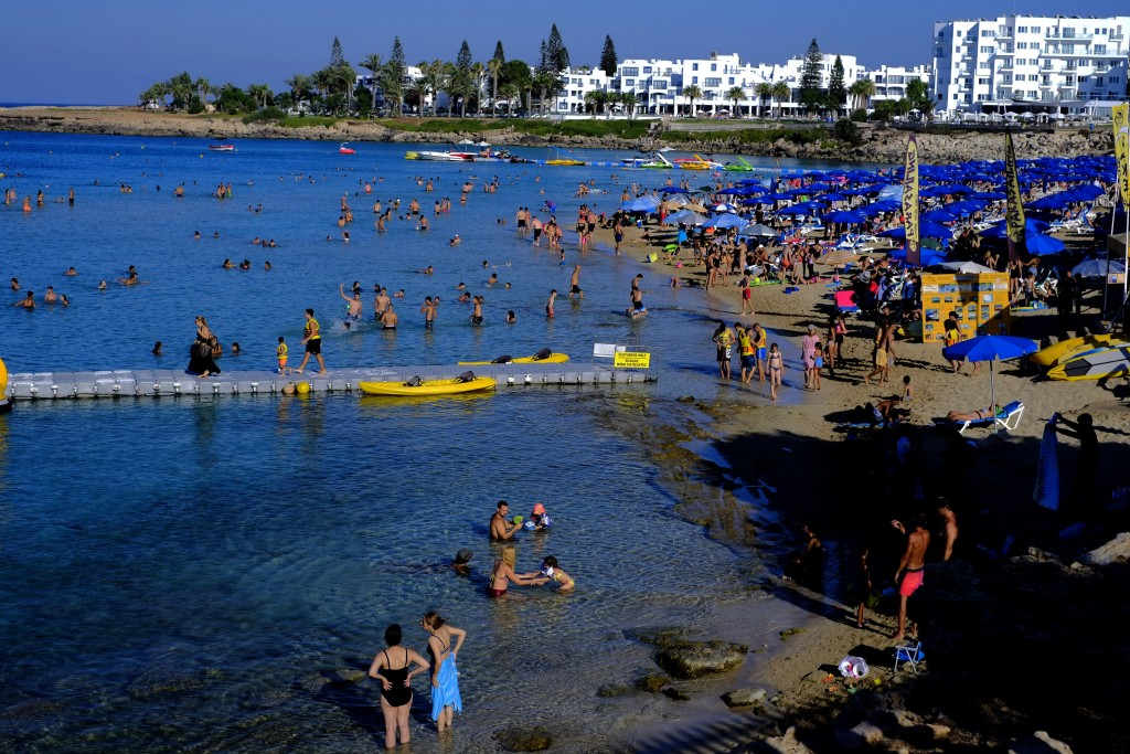 Swimmers cool off from the mid-summer heat in the clear east Mediterranean waters of Cyprus' Fig Tree Bay in the coastal resort of Protaras near Ayia ...