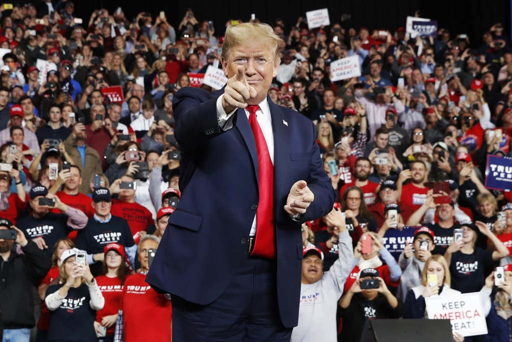 FILE - In this Jan. 9, 2020, file photo, President Donald Trump points as he arrives to speak at a campaign rally, in Toledo, Ohio. (AP Photo/ Jacquel...