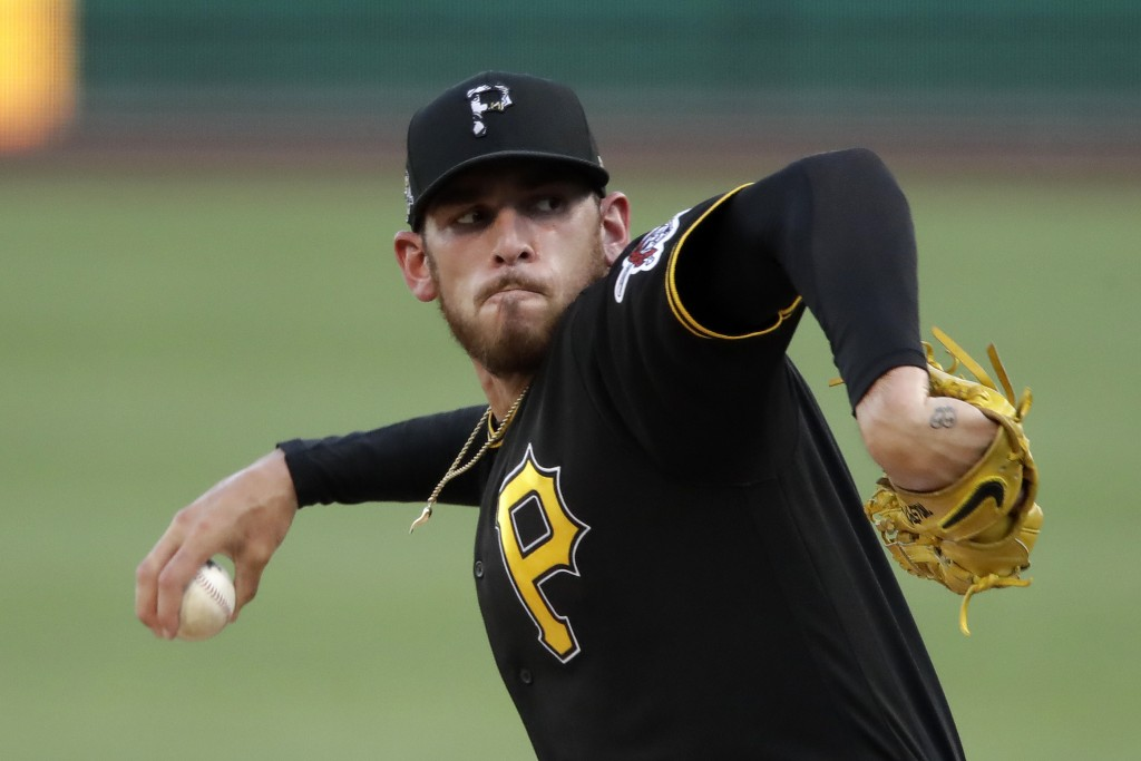 Pittsburgh Pirates' Joe Musgrove delivers during the first inning of an exhibition baseball game against the Cleveland Indians in Pittsburgh, Saturday...
