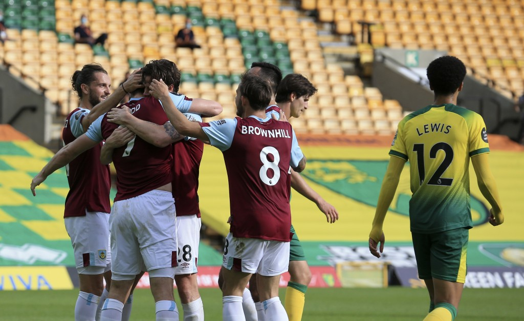 Burnley's Chris Wood celebrates with teammates after scoring his side's opening goal during the English Premier League soccer match between Norwich Ci...