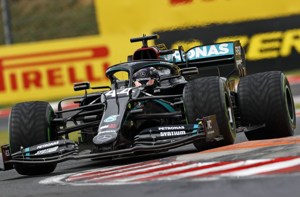 Mercedes driver Lewis Hamilton of Britain steers his car during the Hungarian Formula One Grand Prix race at the Hungaroring racetrack in Mogyorod, Hu...