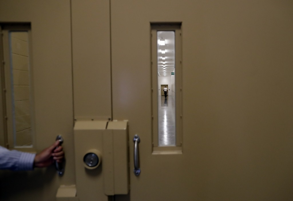 A man walks in a hallway at the Otay Mesa Detention Center Wednesday, Aug. 23, 2017, in San Diego. The facility was at the center of the first big nov...