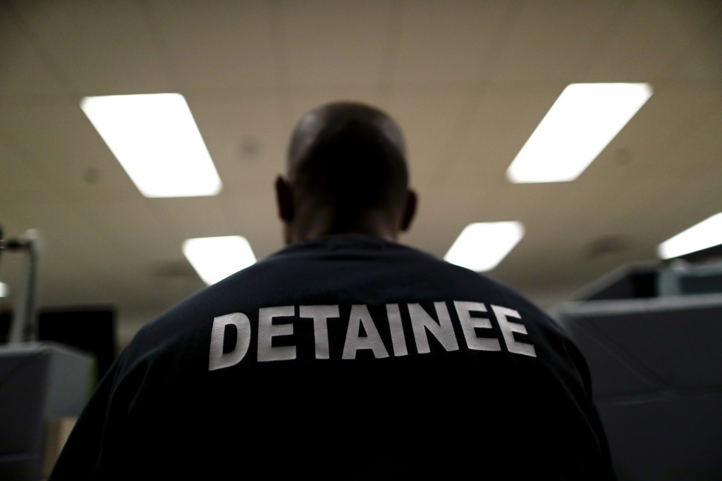 A detainee sits at the Otay Mesa Detention Center Wednesday, Aug. 23, 2017, in San Diego. The facility was at the center of the first big novel corona...