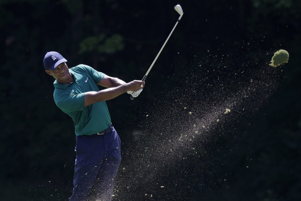 Tiger Woods hits from the 15th fairway during the third round of the Memorial golf tournament, Saturday, July 18, 2020, in Dublin, Ohio. (AP Photo/Dar...