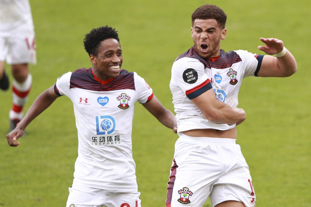 Southampton's Che Adams, right, celebrates with Kyle Walker-Peters after scoring his side's second goal during the English Premier League soccer match...