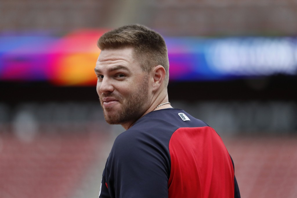 FILE - In this Oct. 5, 2019, file photo, Atlanta Braves' Freddie Freeman looks over his shoulder as he enters the batting cage during a baseball worko...