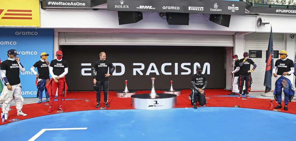 Mercedes driver Lewis Hamilton of Britain takes the knee beside the drivers prior the the Hungarian Formula One Grand Prix race at the Hungaroring rac...