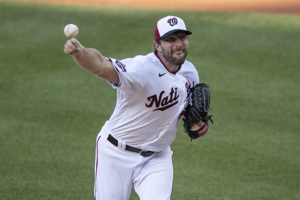 Washington Nationals starting pitcher Max Scherzer throws during the first inning of an exhibition baseball game against the Philadelphia Phillies at ...