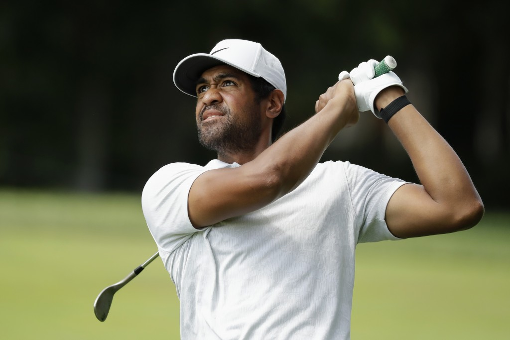 Tony Finau hits toward the ninth green during the third round of the Memorial golf tournament, Saturday, July 18, 2020, in Dublin, Ohio. (AP Photo/Dar...