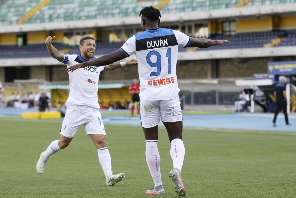 Atalanta's Duvan Zapata, right, celebrates with his teammate Alejandro Gomez after scoring his side's opening goal during the Serie A soccer match bet...