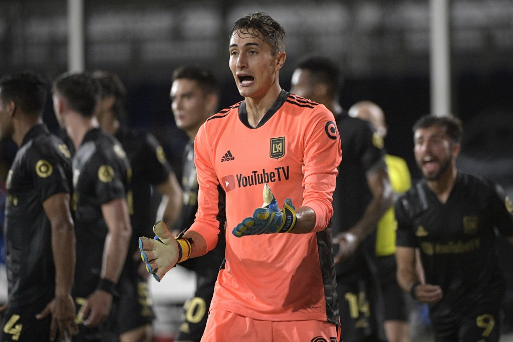 Los Angeles FC goalkeeper Pablo Sisniega argues a call by an official during the first half of an MLS soccer match against the LA Galaxy, Saturday, Ju...