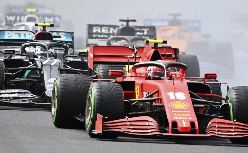 Ferrari driver Charles Leclerc of Monaco steers his car followed by Mercedes driver Valtteri Bottas of Finland during the Hungarian Formula One Grand ...