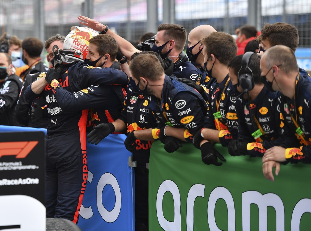 Second placed Red Bull driver Max Verstappen of the Netherlands, left, celebrates with his team after the Hungarian Formula One Grand Prix at the Hung...